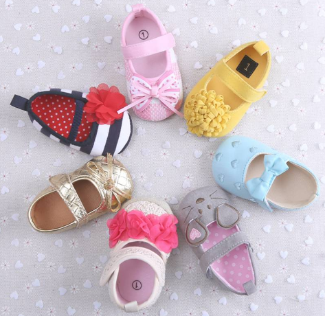 Infant footwear; selecting their first pair of shoes.