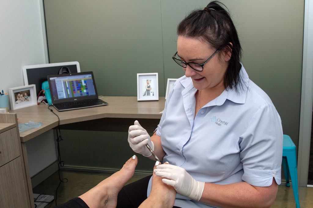 podiatrist performing pedicure
