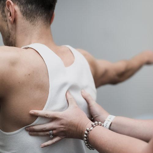 Chiro diagnosing a sore back