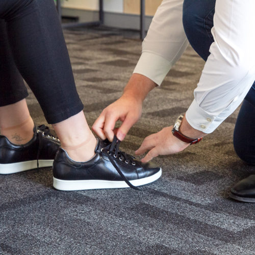 Footwear specialists fitting shoes